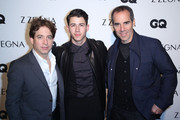 (L-R) Monty Lippman, Singer/Song Writer Nick Jonas, and Charlie Walk arrive at Z Zegna & GQ Celebrate The New Z Zegna Collection Hosted By Nick Jonas at Philymack Studios on February 5, 2015 in West Hollywood, California.