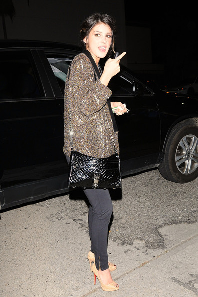 Shenae Grimes A sparkly Shaene Grimes heads back to her car after grabbing a bite to eat at Boards Cafe in West Hollywood.