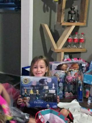 Just days after robbers tried to dampen the Christmas season for a military family in Raeford, a soldier's children spent Christmas Day with huge smiles on their faces as they opened dozens of presents.