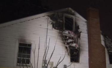 Firefighters extinguished a Wilson house fire late Tuesday night that was started by exploding oxygen and propane tanks.