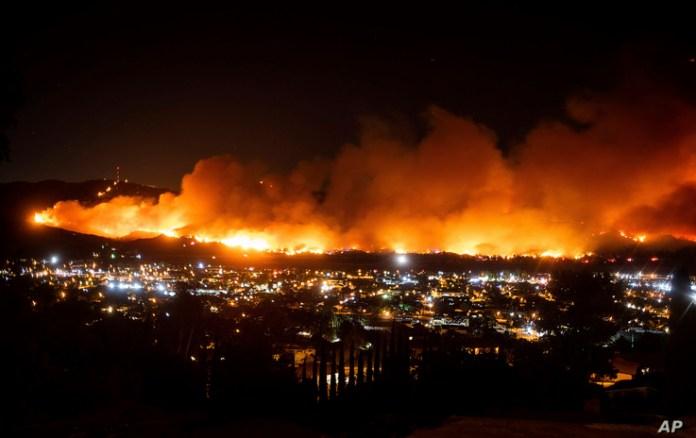 FILE - In this Oct. 31, 2019, file photo, smoke from the Maria Fire billows above Santa Paula, Calif.California regulators are…