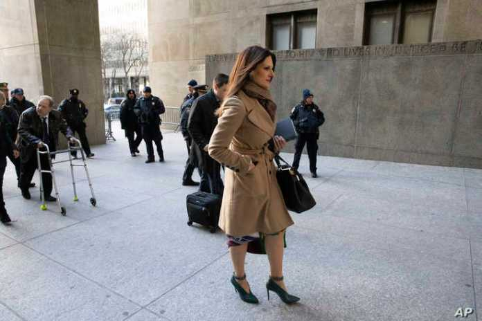 Donna Rotunno walks ahead of her client Harvey Weinstein, left, as they arrive at a Manhattan courthouse to attend jury…