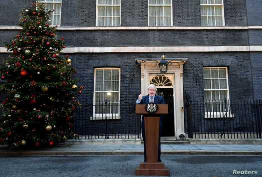Britain's Prime Minister Boris Johnson delivers a statement at Downing Street after winning the general election, in London,…