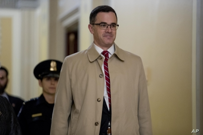 Former top national security adviser to President Donald Trump, Tim Morrison, arrives for a closed door meeting to testify as…