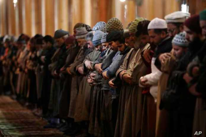 Kashmiri Muslims offer prayer inside Jamia Masjid in Srinagar