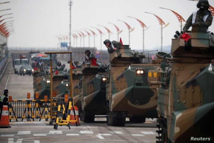 FILE - Amphibious assault vehicles of the South Korean Marine Corps travel during a military exercise as a part of the annual joint military training called Foal Eagle between South Korea and the U.S. in Pohang, South Korea, April 5, 2018.