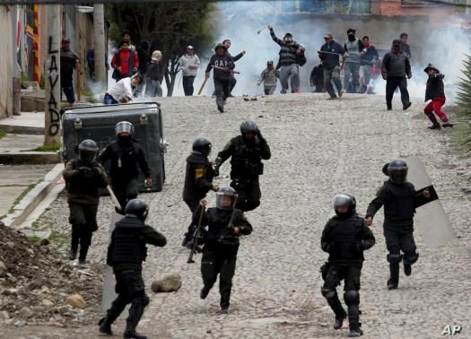 Supporters of former President Evo Morales clash with police in La Paz, Bolivia.
