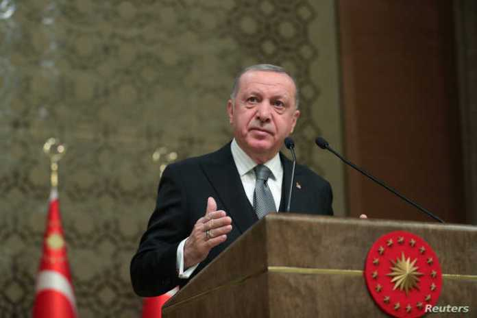 Turkish President Tayyip Erdogan speaks during a symposium in Ankara, Turkey, January 2, 2020. Murat Cetinmuhurdar/Presidential…