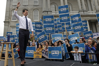 Democratic presidential candidate South Bend, Ind., Mayor Pete Buttigieg waves to supporters outside the Statehouse, Wednesday,…