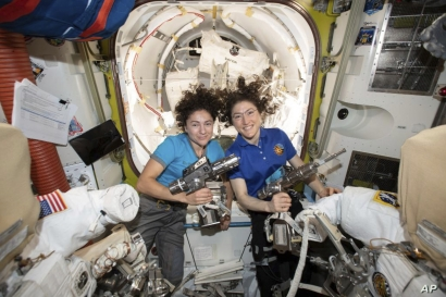 In this photo released by NASA on Thursday, Oct. 17, 2019, U.S. astronauts Jessica Meir, left, and Christina Koch pose for a…