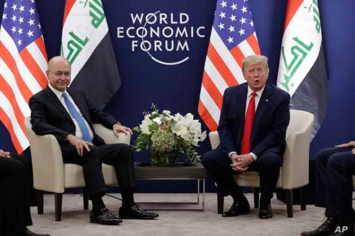 US President Donald Trump, right, attends a meeting with his Iraqi counterpart Barham Salih at the World Economic Forum.
