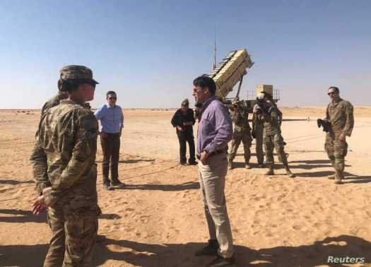 U.S. Defense Secretary Mark Esper speaks with U.S. troops in front of a Patriot missile battery at Prince Sultan Air Base in…