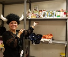 Rebecca (dressed for hat day) shows Glen Haven's small food pantry closet