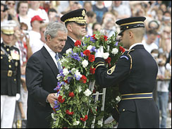 President Bush lays a wreath at the Tomb of the Unknowns at Arlington Nat'l Cemetery.