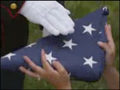 Real flag, but actors hands.  Screen grab of RNC video by CBS News