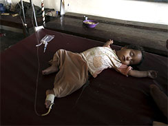 A Pakistani flood affected child suffering from diarrhea lies in a make-shift hospital set up at a camp in Nowshera, Pakistan, Aug. 13, 2010. Fever, stomach problems and skin diseases are spreading among Pakistani flood victims.