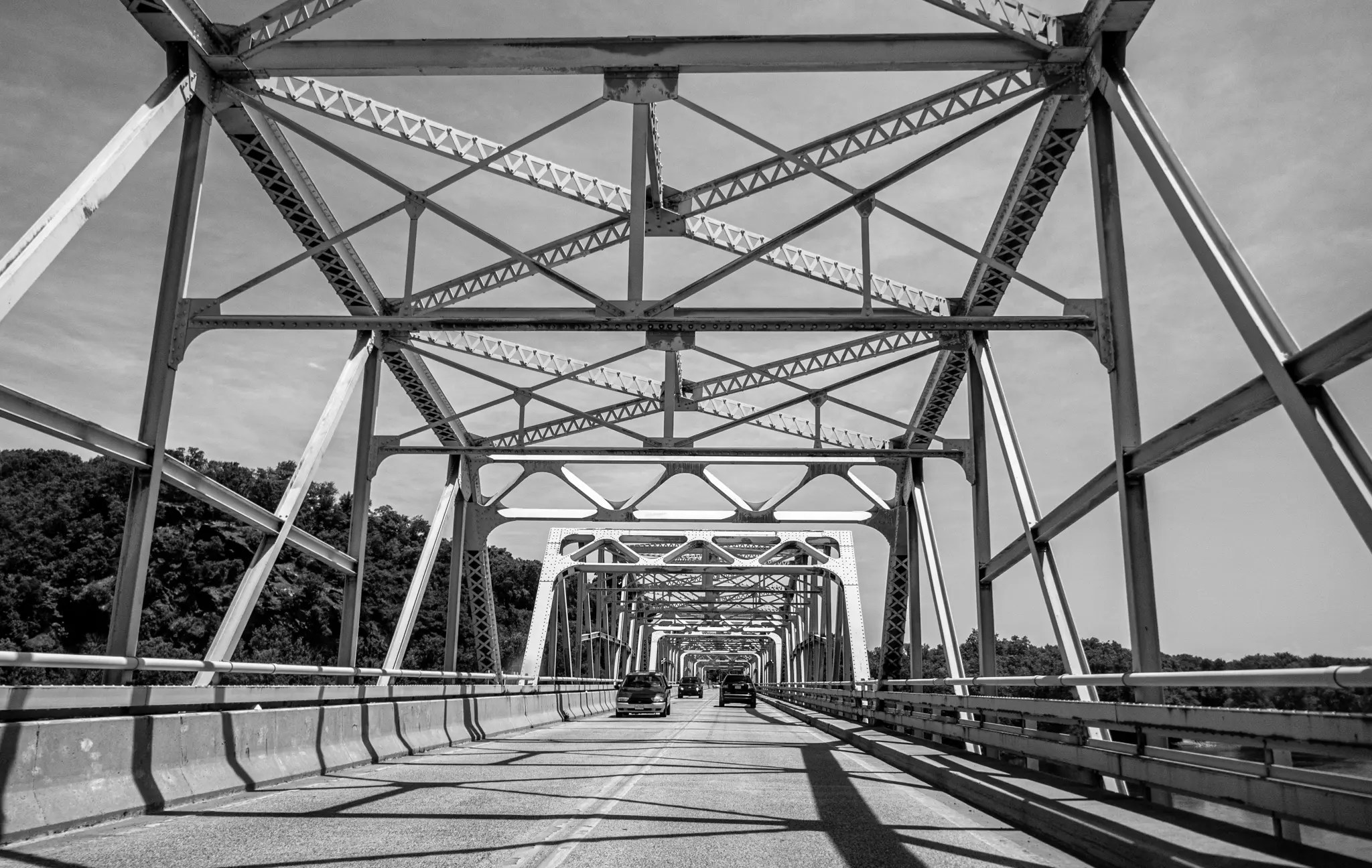Steel bridge with cars under a clear sky