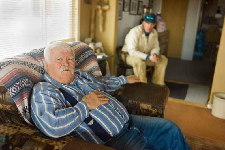 Louis Meeks at home in Pavillion with John Fenton. (Angus M. Thuermer Jr./WyoFile)
