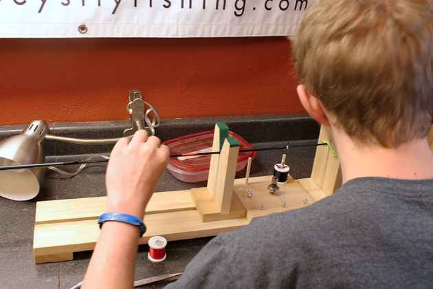 Trevor White builds a fly fishing rod at Joey's Foundation. Rod building is an exercise in patience, says founder Joey Puettman. (Kelsey Dayton/WyoFile)