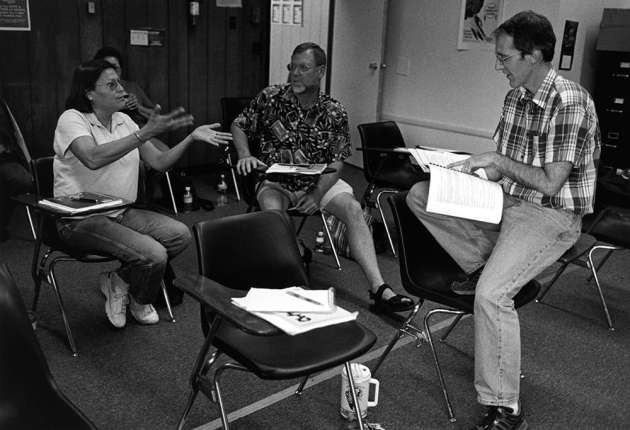 Andrew Cowell (right) and Arydenne Sage (left) discuss Arapaho language lessons at Wind River Tribal College, in 2003. (courtesy Sara Wiles)