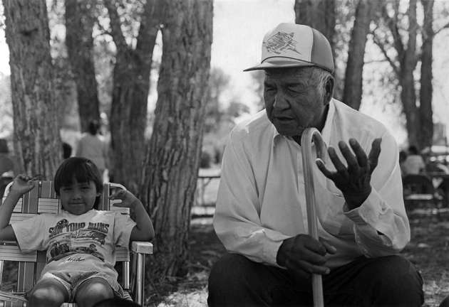 Pius Moss tells stories at the 1989 Arapaho Language and Culture Camp.  Photo by Sara Wiles, 1989. (7/89.04.30)