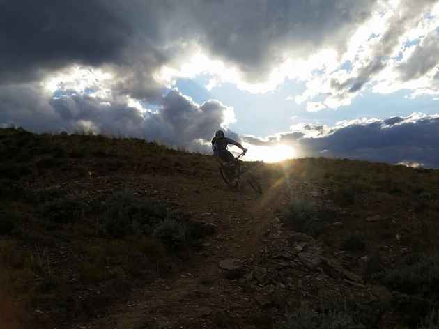 A mountain biker comes around a corner on a trail near Cody, one of several Wyoming communities making efforts to create new trails. (courtesy John Gallagher