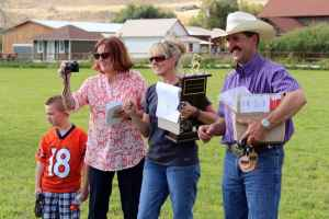 Christy Stock, Cindy Cobb, and Jack Cobb host the tournament. The family has ranched in Savery since the 1880s, and has employed Mexican and Peruvian workers since the 1960s. (Gregory Nickerson/WyoFile)