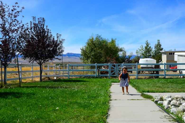 Amarie Swallow runs in the yard of her grandparents' home. Experts say social, economic and environmental risk conditions are more predictive of someone's lifelong well-being than the things they can control. (Matthew Copeland/WyoFile)