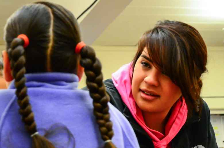 Belva Day volunteers at Fort Washakie elementary school. She recently participated in an exercise where classmates and teachers try to remain silent as somebody tries to make them laugh. (Matt Copeland/WyoFile)
