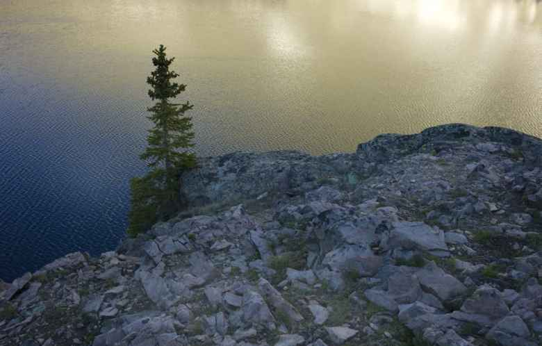 Alpine lakes in the Wind River Range, like this one in the Dinwoody drainage, hold pure, clear water. But the Wyoming Department of Environmental Quality wants to lower the standard for E. coli for most state waterways. (Angus M. Thuermer Jr./WyoFile)