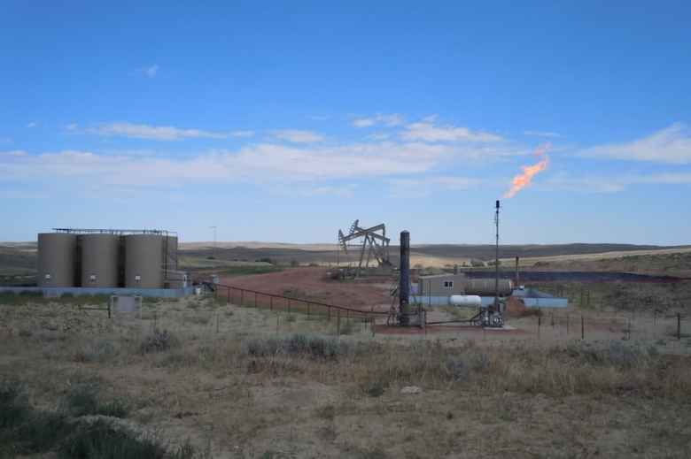 An oil well in Campbell County flares methane, adding to atmospheric pollution and wasting a valuable public resource. Proposed new BLM rules would help restrict such waste. (Courtesy Powder River Basin Resource Council)