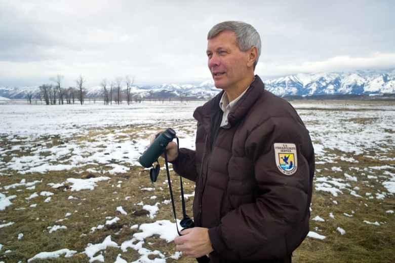 National Elk Refuge Manager Steve Kallin scans the refuge during a recent tour of the preserve near Jackson. Kallin is wary of what might happen when Chronic Wasting Disease arrives. He fears that the unnatural concentration of animals created by offering supplemental feed will accellerate spread of the disease and contaminate the landscape, perhaps for decades. (Angus M. Thuermer Jr./WyoFile)