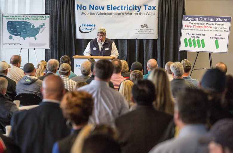 Wyoming Mining Association assistant director Travis Deti mocked concerns over climate change at a Friends of Coal rally in Casper. (Tim Kupsick/WyoFile)