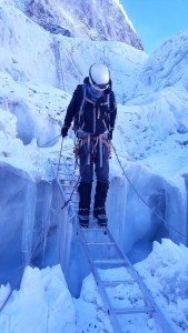 Rogers picks his way across a ladder over a crevasse during his recent expedition to Mount Everest. The mountain's ice features are among it's most treacherous terrain. (Photo courtesy of Darren Rogers)