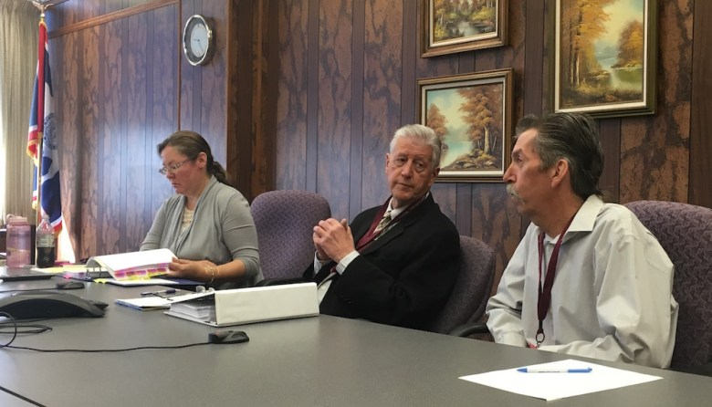 Casper resident Lee Mosser (far right) testifies at a recent hearing with his attorney Hampton Young (center), while attorney Amy Taheri represents Wyoming Workers' Compensation. (Dustin Bleizeffer/WyoFile)