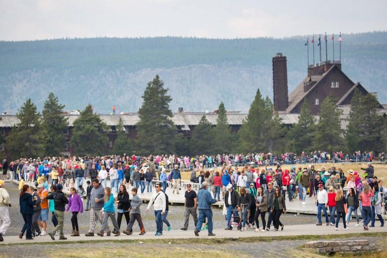 Crowds walk near Old Faithful in Yellowstone National Park. (Photo courtesy NPS/Neal Herbert)
