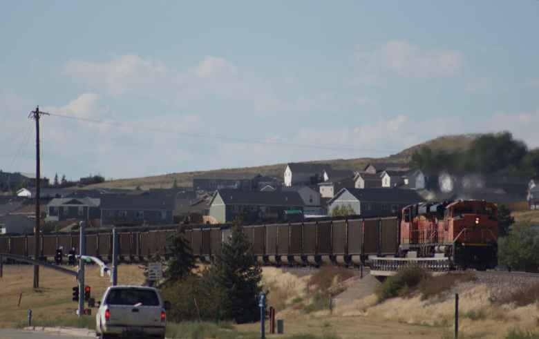 A coal train rolls out of Gillette. A recent uptick activity at the mines has led to some optimism that Gillette's economy, heavily based on coal, might at the very least be stabilizing. (Andrew Graham)