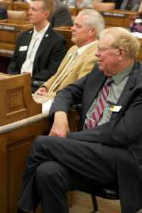 Sen. Charles Scott (R, SD-30, Casper) listens to Gov. Matt Mead give his State of the State speech on Jan. 11. In the speech, Gov. Mead requested $21 million in contingency funding to pay for Title 25's rising costs. (Andrew Graham/WyoFile)