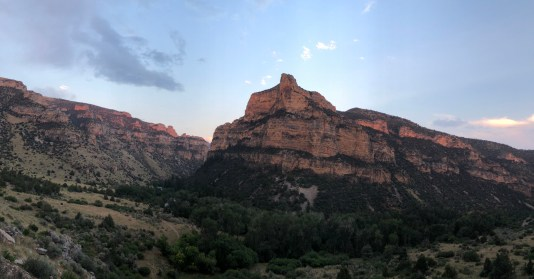 Learn the fundamentals of ultralight backpacking and Leave No Trace practices with Wyoming Mountain Guides' Intro to Backpacking Courses. Photo of a midsummer Wyoming sunset over lower Paint Rock Canyon, near Hyattville Wyoming.