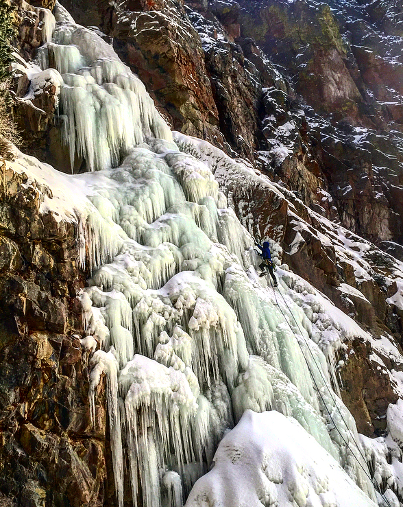 Photo of our guide ice climbing at Five Springs Falls near Lovell Wyoming in the northern Bighorn Basin