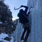 Lead ice climbing guide Zach Lentsch climbs the Wildfire Slabs in early January 2019