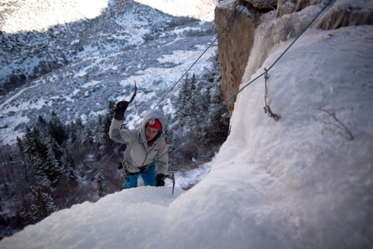 Wyoming Mountain Guides' apprentice guide Kaitlin Dooling warms up on a frigid day of ice climbing in Cottonwood Canyon