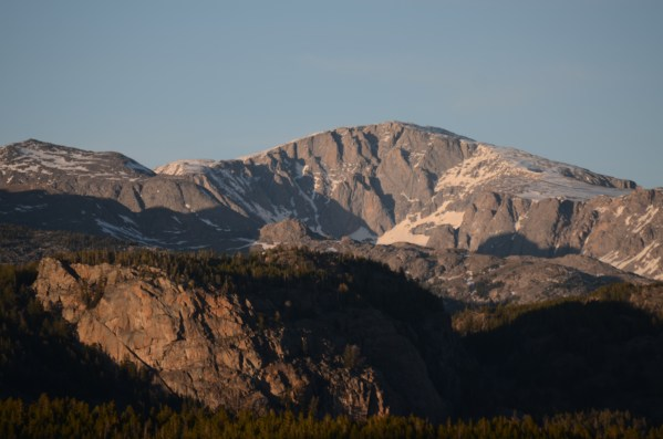 Learn the fundamentals of non-glaciated mountaineering with Wyoming Mountain Guides as we venture into the heart of Cloud Peak Wilderness and summit Cloud Peak. Photo of sunset on the west face of Cloud Peak.