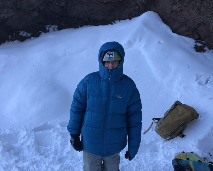 Ice climber bundles up to stay warm in cold winter conditions