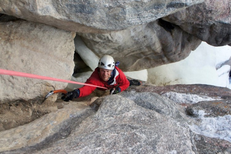 Mixed climbing course participant Scott Davis pulls the crux of a traditional mixed climb in Shell Canyon