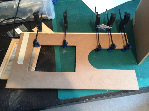 Gluing a small piece of wood to the side to make it fit