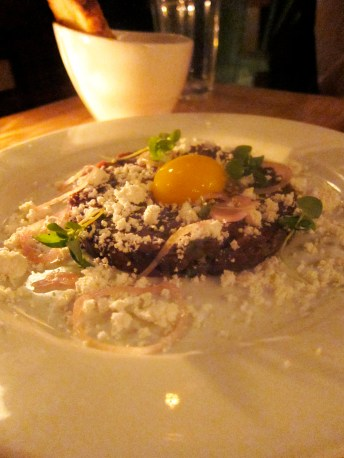 Horse Tartare with raw egg and bone marrow snowflakes.