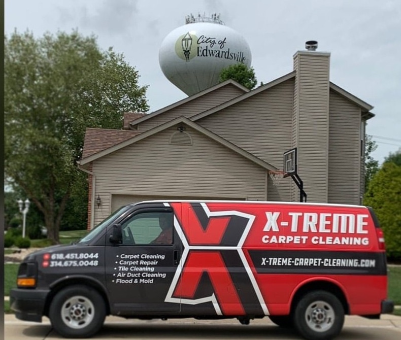 "Your ""Local"" carpet & upholstery cleaning specialist wrapped van under Edwardsville water tower"