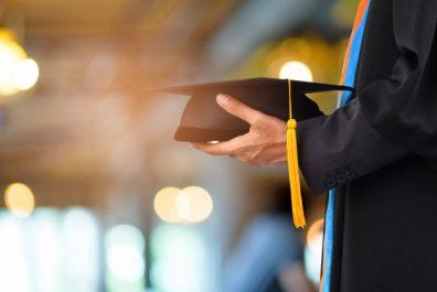 graduation-take-black-yellow-tassel-front-bokeh-blurry-background_43157-129-1