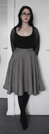 Stretch cotton top with full mesh sleeves. Full circle checkered wool skirt